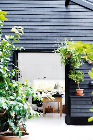 black wooden house in Denmark