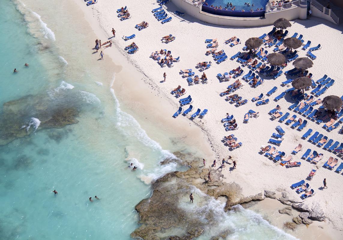 Gray Malin A La Plage A La Piscine caribbean-resort-blue-chairs