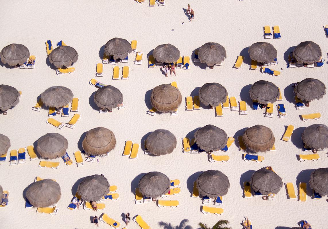 Gray Malin A La Plage A La Piscine tiki-umbrellas-yellow-chairs